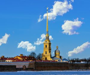 spire of the Peter and Paul Fortress with the other bank of the Neva River in Saint Petersburg in winter